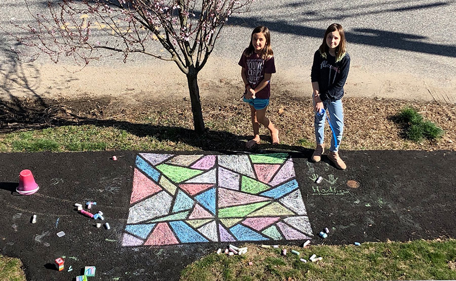 Chloe and Hadley Bergeron and some sidewall art they made.