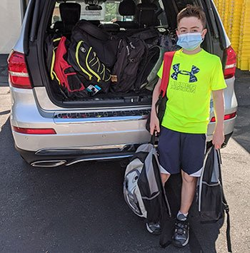 Michael McGrath, of Quincy, donated 20 backpacks with supplies to Interfaith Social Services' Backpack Drive. Michael created his own fundraiser to pay for the backpacks, running 1 mile a day for 20 days as he gathered pledges from friends and family.